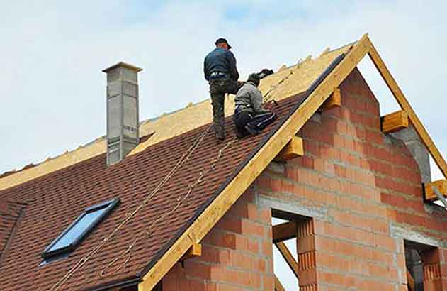 Mens Working On Top Roof